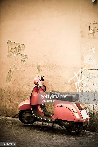 Pink scooter and Roman wall, Rome Italy