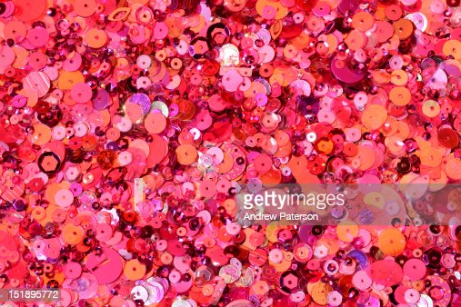 Pink sequins of various shapes and sizes