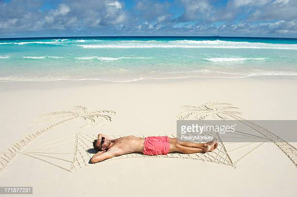 Pink Shorts Man Relaxes in Hammock Tropical Sand Beach