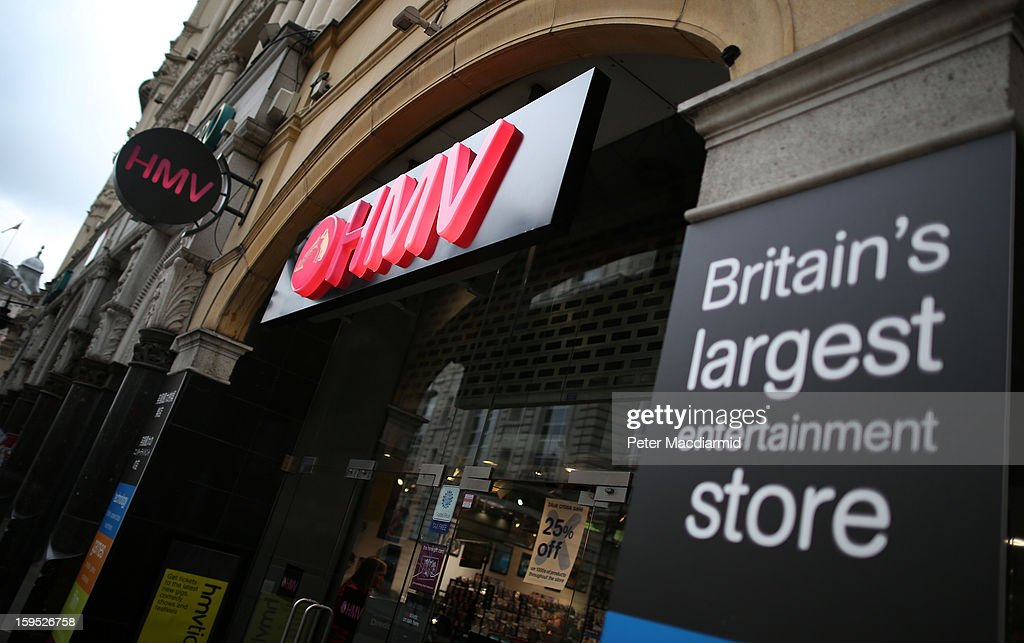 A pink sign glows at the entrance to the HMV music and video shop in Piccadilly on January 15, 2013 in London, England. Management have announced that administrators have been called in which may put the 4350 staff at risk. HMV was founded in 1921 has 239 stores in the UK and the Republic of Ireland and has struggled to compete against online retailers.