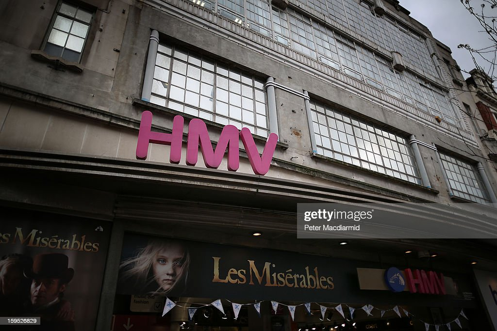 A pink sign stands over the entrance to the HMV music and video shop in Oxford Street on January 15, 2013 in London, England. Management have announced that administrators have been called in which may put the 4350 staff at risk. HMV was founded in 1921 has 239 stores in the UK and the Republic of Ireland and has struggled to compete against online retailers.