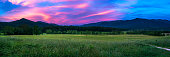 Pink skies at sunset at Cades Cove in the Great Smoky Mountains.