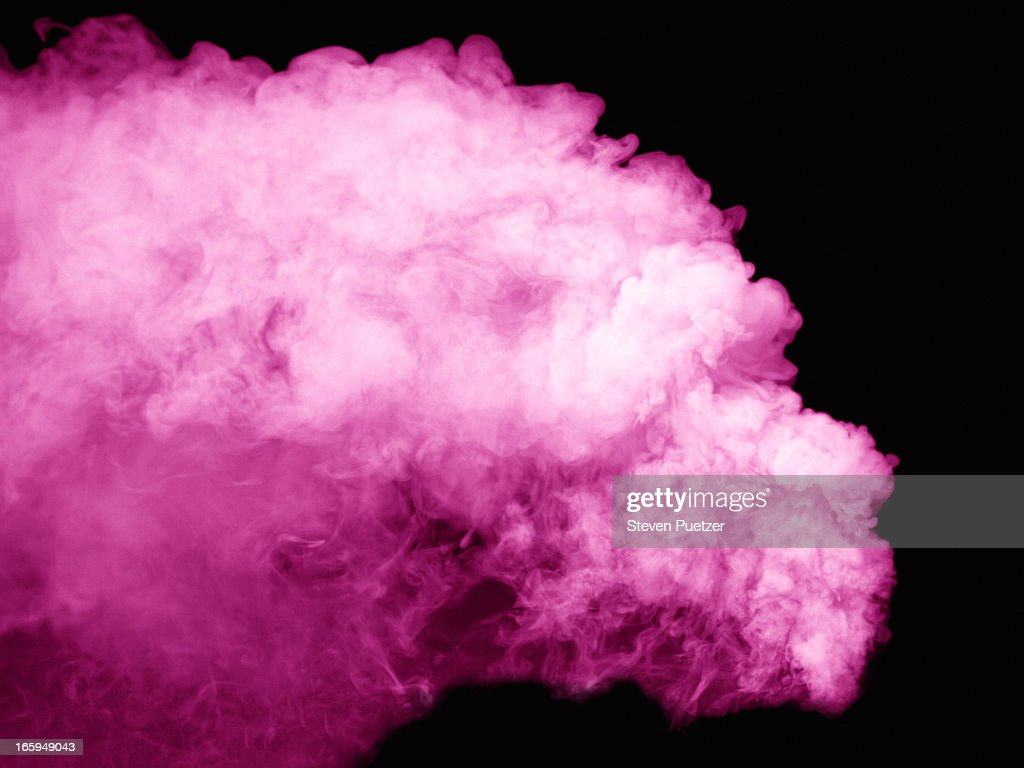 Pink smoke against black background