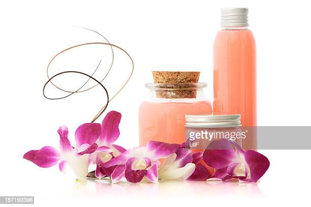 Pink soap bottles and flowers