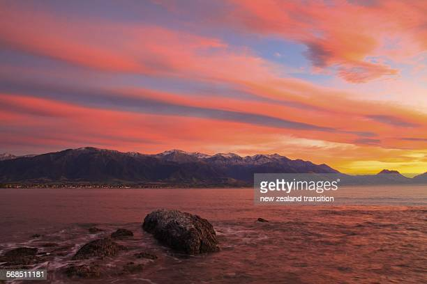 Pink sunrise over snow capped Kaikoura ranges