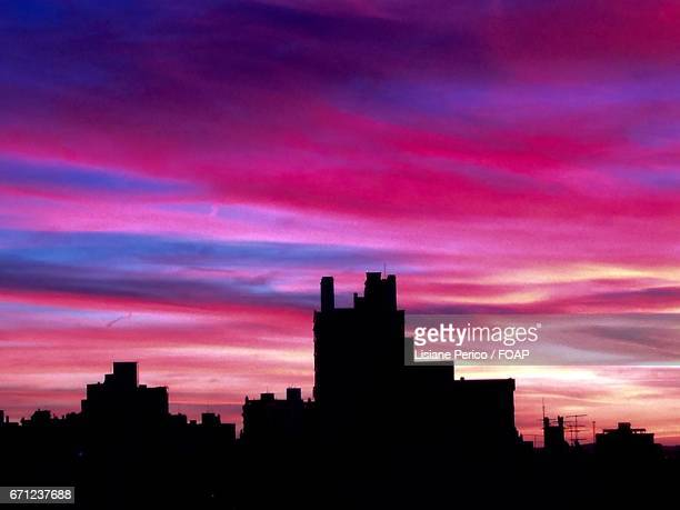 Pink sunset with silhouette skyline