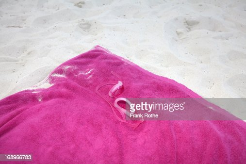 pink swimming googles on a pink beach towel : Stock Photo