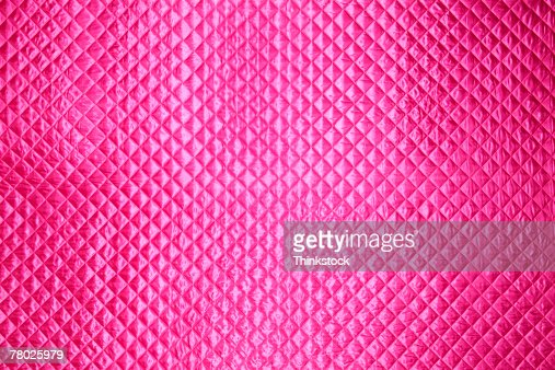 Pink textured background.