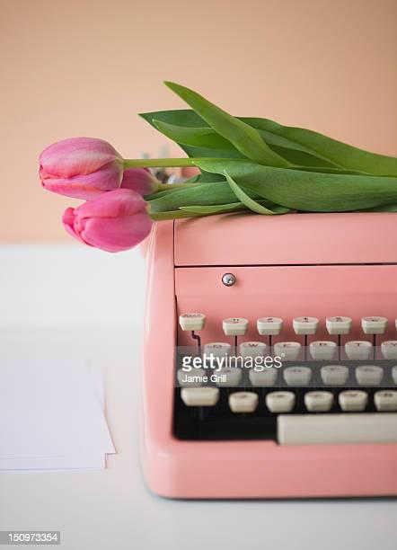 Pink typewriter and tulips