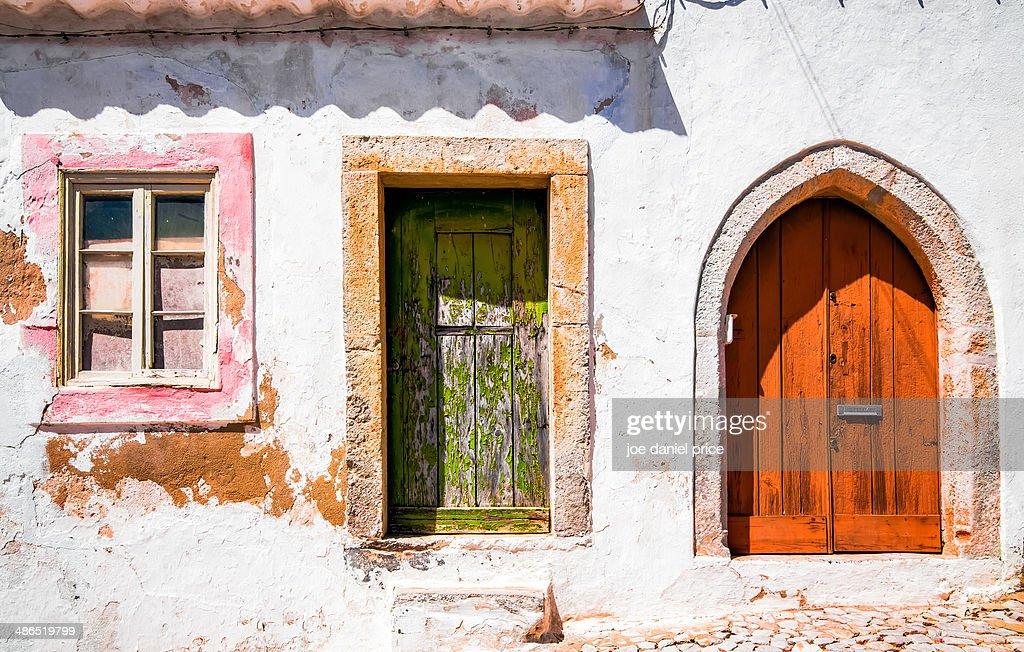 Pink window green door orange door Tavira Portugal