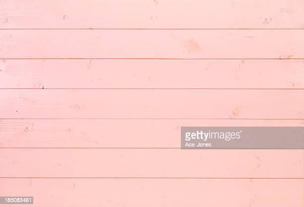 ピンクの木製の背景