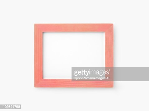 A Pink Wooden Frame on a White Background : Foto de stock