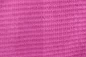 Photo of pink yoga mat closeup.