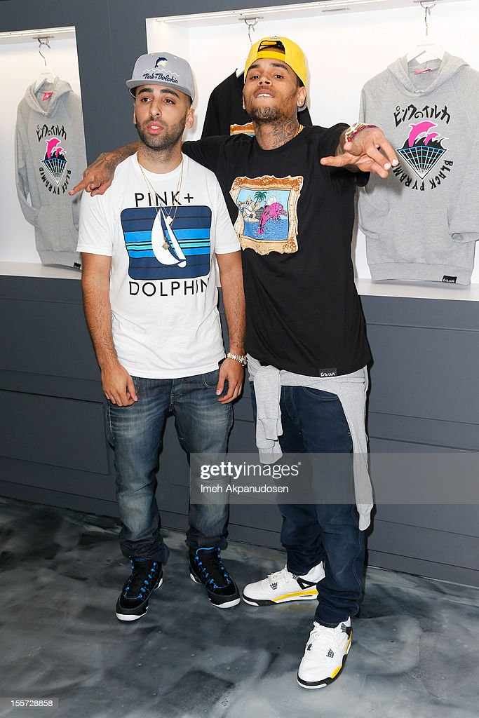 Pink+Dolphin CEO Neima Khaila (L) and singer Chris Brown attend a special in-store meet and greet celebration at Pink+Dolphin on November 7, 2012 in Los Angeles, California.