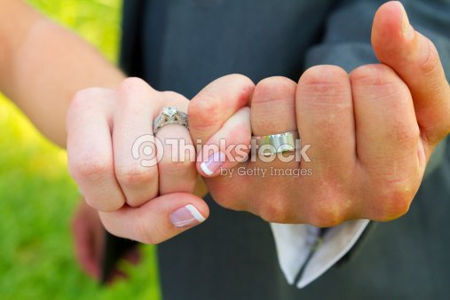 I Swear Wedding Photography: Pinky Swear Wedding Rings Stock Photo