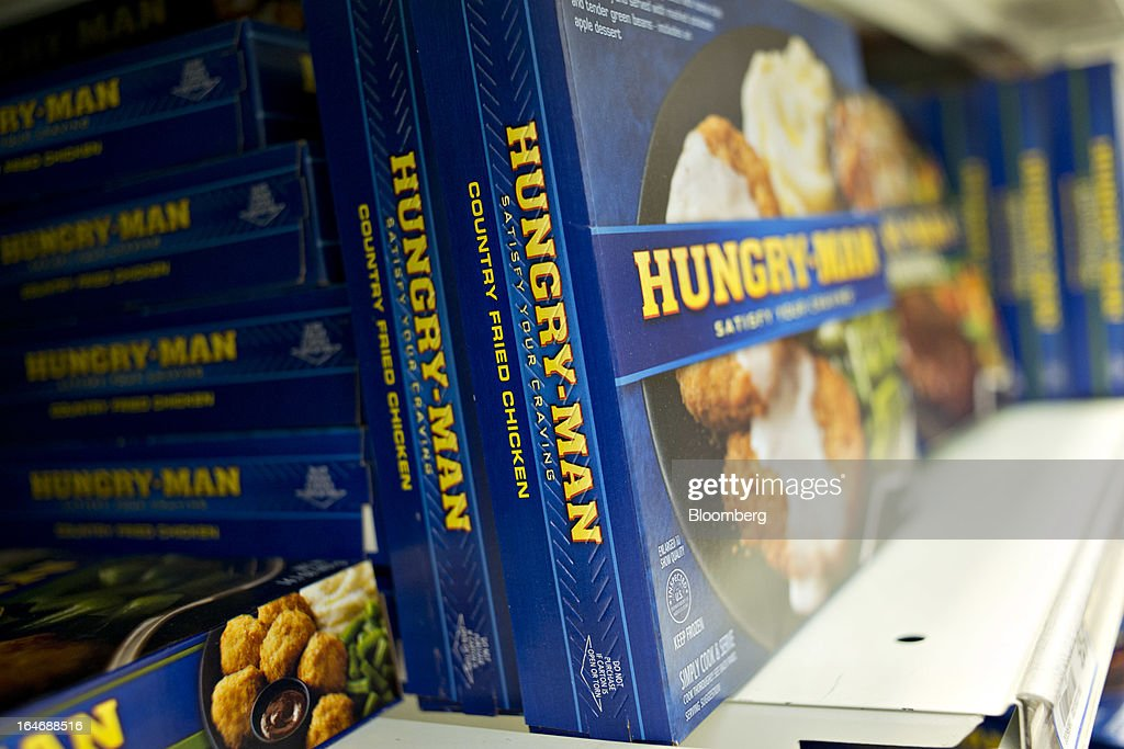 Pinnacle Foods Hungry-Man brand frozen dinners sit on display for sale at a supermarket in Princeton, Illinois, U.S., on Tuesday, March 26, 2013. Pinnacle Foods Inc., the maker of Birds Eye frozen vegetables and Hungry-Man dinners owned by Blackstone Group LP, plans to raise as much as $580 million in an initial public offering that would value the company at about 2.1 billion. Photographer: Daniel Acker/Bloomberg via Getty Images
