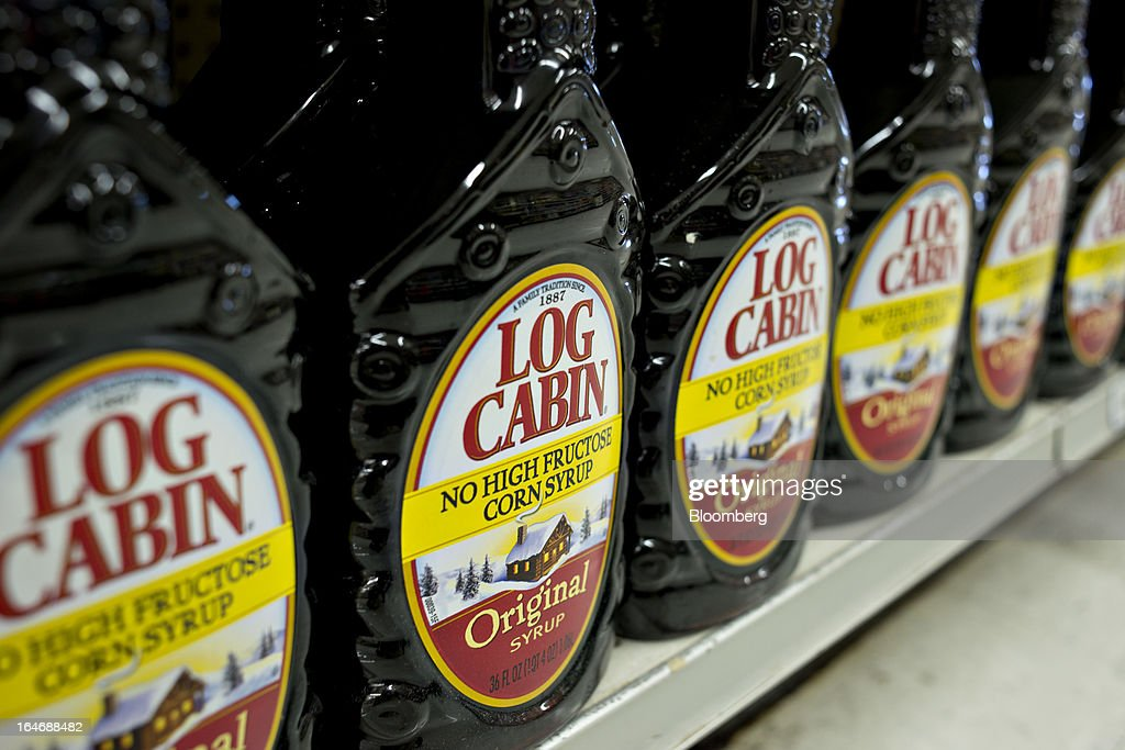 Pinnacle Foods Log Cabin brand syrup sits on display for sale at a supermarket in Princeton, Illinois, U.S., on Tuesday, March 26, 2013. Pinnacle Foods Inc., the maker of Birds Eye frozen vegetables and Hungry-Man dinners owned by Blackstone Group LP, plans to raise as much as $580 million in an initial public offering that would value the company at about 2.1 billion. Photographer: Daniel Acker/Bloomberg via Getty Images