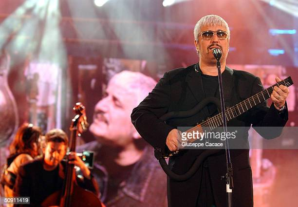 Pino Daniele performs on stage during the first concert of the Festivalbar May 29 2004 in Milan Italy The Festivalbar tours throughout Italy during...
