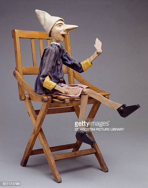 Pinocchio in wood with painted papier mache head inspired by the illustrations of Carlo Chiostri Italy 20th century Milan Museo Del Giocattolo E Del...
