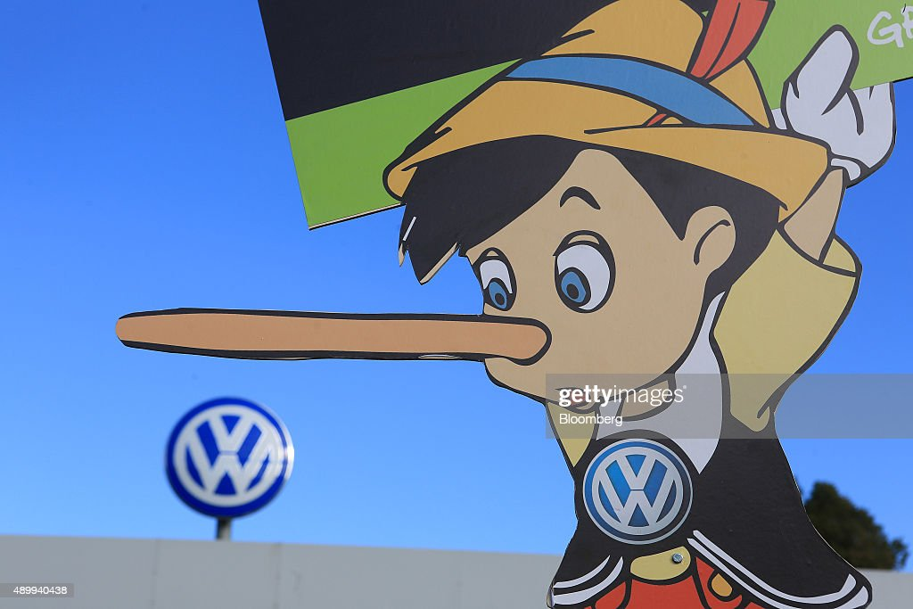 A Pinocchio placard stands during a protest by members of the environmental action group Greenpeace outside the Volkswagen AG headquarters in...