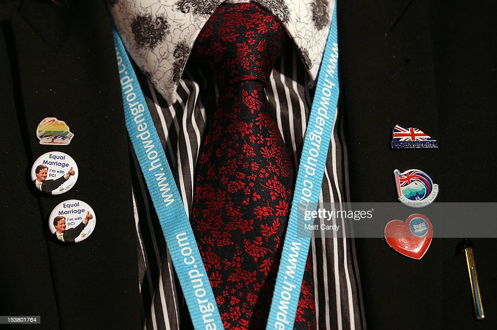 Pins are displayed on a delegate as he listens to Home Secretary Theresa May at the Conservative party conference in the International Convention Centre on October 9, 2012 in Birmingham, England. Today's penultimate day of the annual, four-day Conservative party conference features speeches from Cabinet ministers and the Mayor of London.