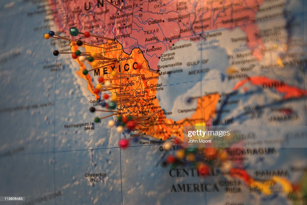 Pins in a map mark the origins of immigrants who have received assistance at the Immigrant Resources Center on May 10 2011 in Littleton Colorado The...