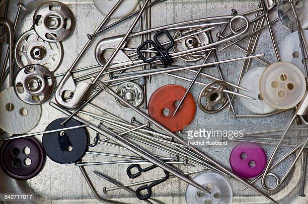 Pins, needles, safety pins, buttons and poppers