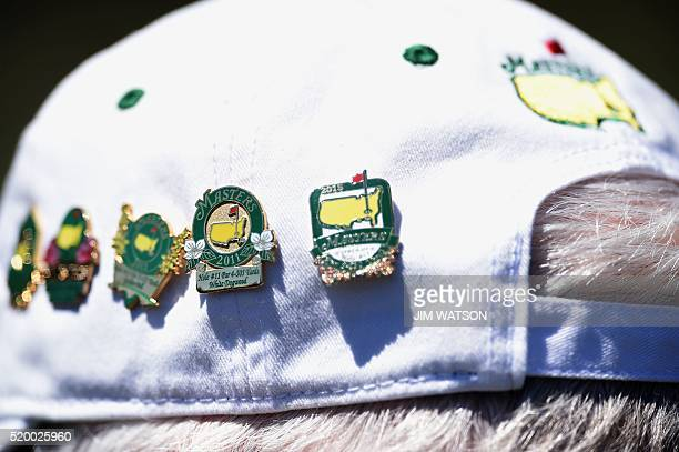 Pins with Masters logo are seen on a patron's hat during Round 3 of the 80th Masters Golf Tournament at the Augusta National Golf Club on April 9 in...