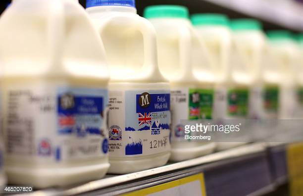 Pint cartons of milk sit on display at a Morrisons supermarket operated by William Morrisons Supermarkets Plc in Crawley UK on Tuesday March 3 2015...