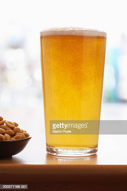 Pint of beer by peanuts