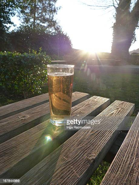 A pint of beer on a garden table