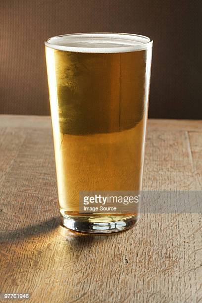 Pint of beer on table
