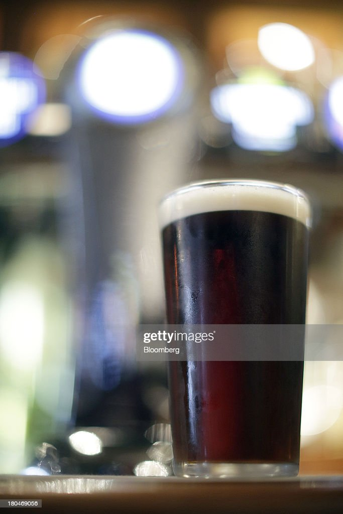 A pint of bitter beer sits on the bar inside a JD Wetherspoon Plc pub in London, U.K., on Friday, Sept. 13, 2013. JD Wetherspoon, who reported full year sales today, are planning to move into the Irish market next year, Chairman Tim Martin said in a recent interview. Photographer: Matthew Lloyd/Bloomberg via Getty Images