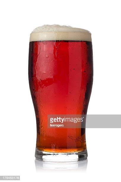 Pint of dark ale on a white background