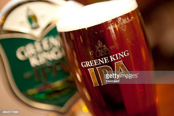 A pint of Greene King IPA in a branded glass