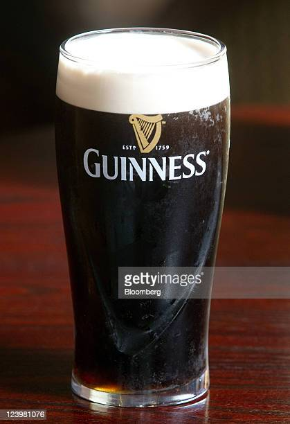 A pint of Guinness is seen at The Knights Templar public house operated by JD Wetherspoon Plc in London UK on Wednesday Sept 7 2011 UK retail sales...