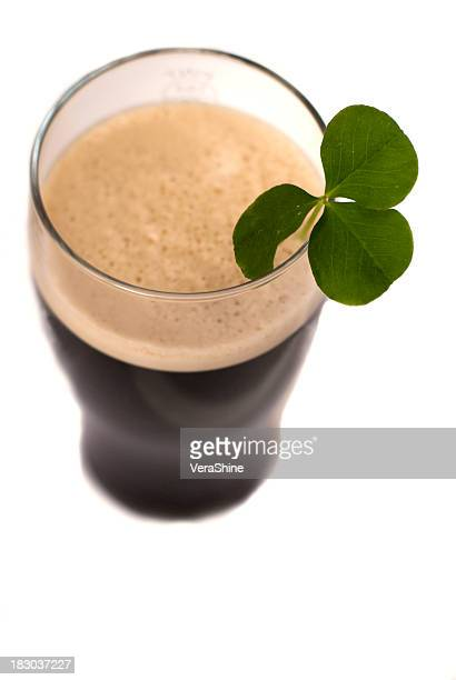 Pint of Guinness seen from above with a clover in it