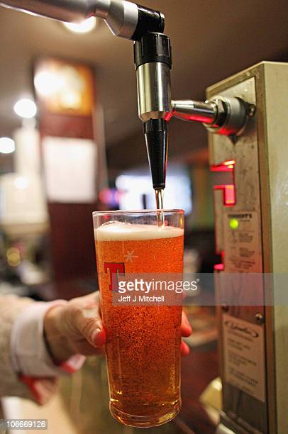 A pint of lager is served in a Govan pub on November 10 2010 in Govan Glasgow Scotland MSP's are set to vote on the SNP government's Alcohol Bill...