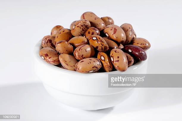 Pinto beans in ceramic bowl, close-up