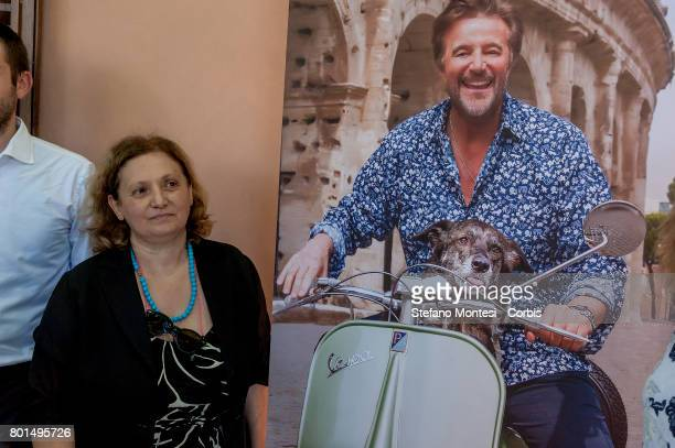 Pinuccia Montanari Counselor for Environmental Sustainability of Rome Capital near the poster of the advertising campaign with Christian De Sica...