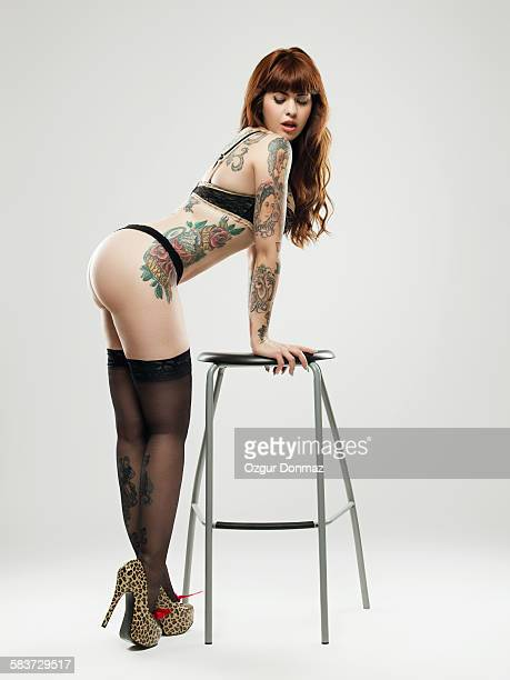Pin-up curvy girl with tattoos