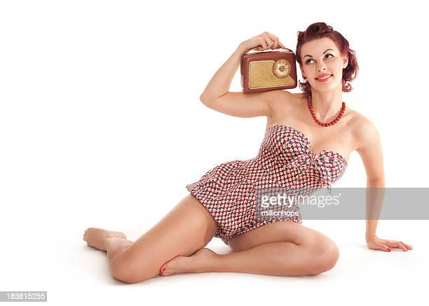 Pin-up girl with old radio