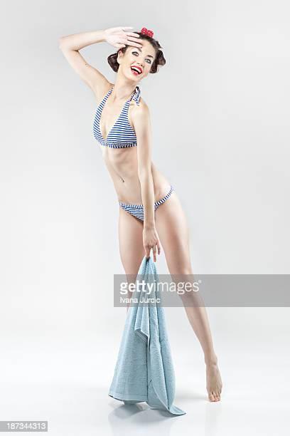Pin-up Portrait of Young Woman in Striped Bikini