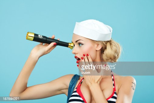Pin-up style of sailor woman with telescope