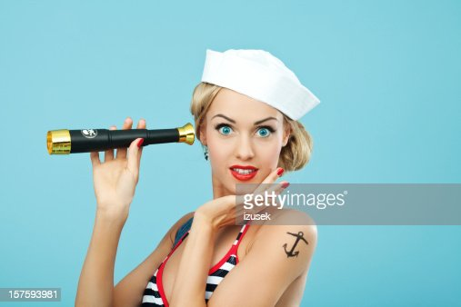 Pin-up style sailor woman holding telescope