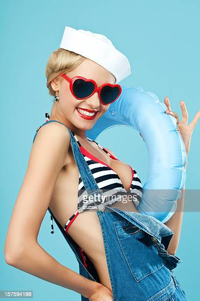 Pin-up style sailor woman with sunglasses and lifebouy