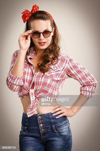 Pin-up style young woman with sunglasses