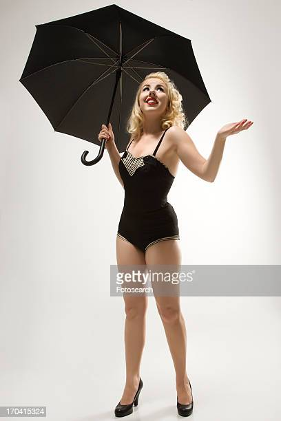 Pinup woman holding an umbrella