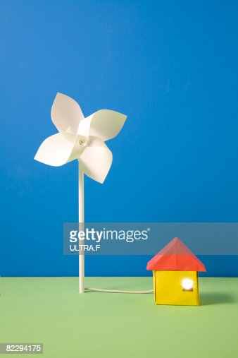 Pinwheel and house made out of paper : Stock Photo