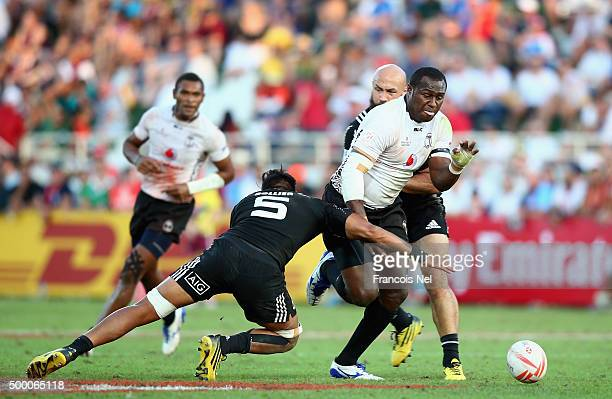 Pio Tuwai of Fiji is tackled by Dylan Colier of New Zealand during the Emirates Dubai Rugby Sevens HSBC World Rugby Sevens Series Cup Semi Final at...